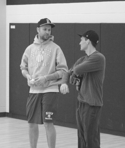 Puskar speaks with assistant Coach Joe Leonette during practice on Feb. 23. Photo by Bradford Douglas.