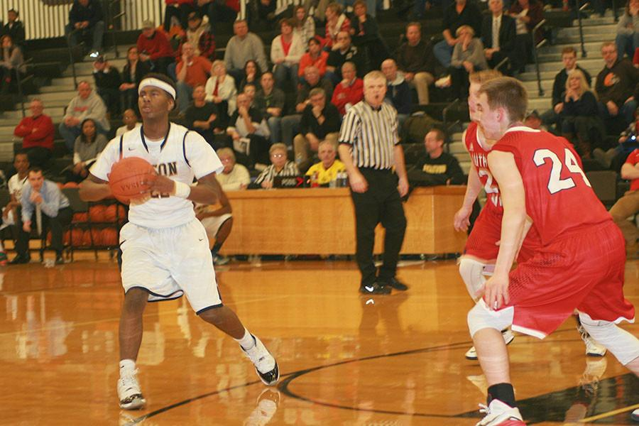 Jalen Davis steps into a pass against Lutheran West. Photo from Bcomber archives by C.J. Kitson.