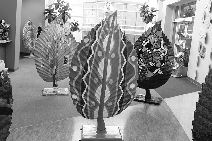 Greg Perry's junior achievement marketing class sold commemorative beech leaves to local businesses. Some of the leaves are on display at the Beachwood Community Center. Photo by Bradford Douglas.