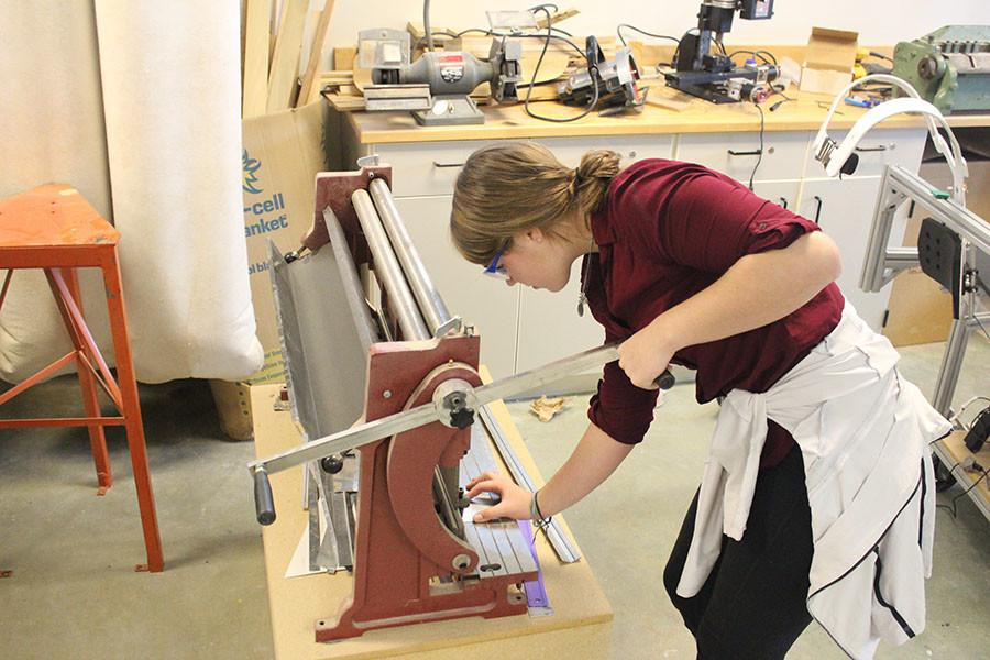 Sophomore Claire Bruening works on construction for the BHS robotics team. Photo by Bradford Douglas.