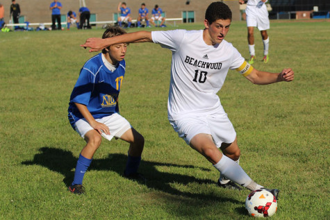 Senior Captain Bagatur Askaryan controls the ball in the game against Notre Dame Cathedral Latin on Aug. 27. The Bison won 6-0. Photo by Bradford Douglas.