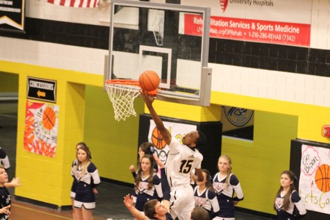 Maishe Dailey scores at a home game. Photo by Bradford Douglas.