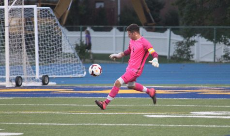 Senior goalie Griffin Davis defends the goal in the season opener against Independence. Photo by Livia Eppell.