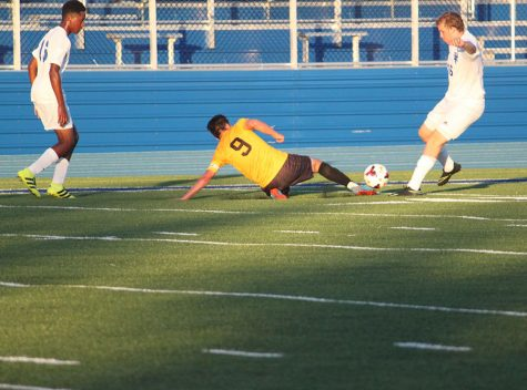 Senior Shai Yulish dives for the ball in the season opener against Independence. Photo by Livia Eppell.