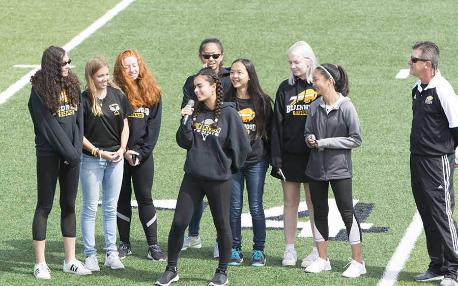 Captain Gabriela Rodriguez and the girls tennis team speak at the fall pep rally on Sept. 1. Photo by Gabriela Covolan Costa.