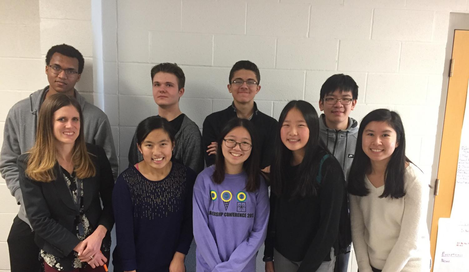 Front row (left to right): Coach Karla Seery, Jing-Jing Shen, Somin Jung, Sunny Wang, Athena Grasso Back row (left to right): Maxwell Rackmill, Peter Soprunov, Zyad Shehadeh, Yang Yu. Photo by Michael Schmidt