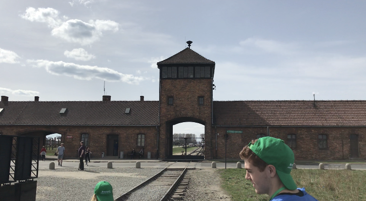 The+exterior+of+Auschwitz+II-Birkenau++hovers+over+the+train+track+that+was+once+used+to+usher+in+thousands+of+Jews+at+once+to+prepare+them+for+gassing.+Photo+by+Max+Alter