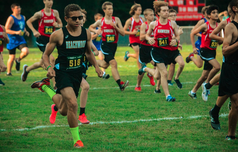 Freshman Greg Perryman running at the Hawken Invitational. Photo by Elizabeth Metz