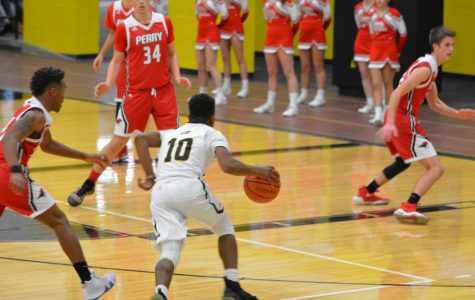 Bison Basketball Defeats Perry