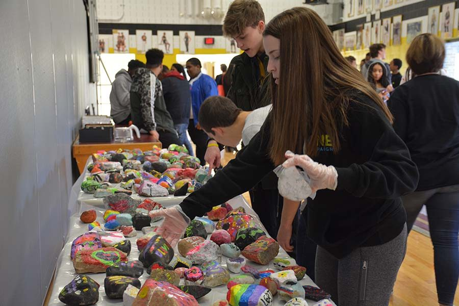 Students painted rocks at last year's One Bison Summit. Photo from Beachcomber archives by Amy Chen