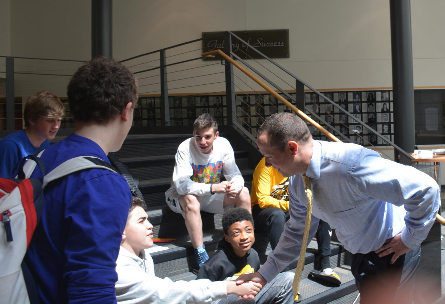 Paul Chase greets students at the high school on Monday, May 20. Photo by Prerna Mukherjee