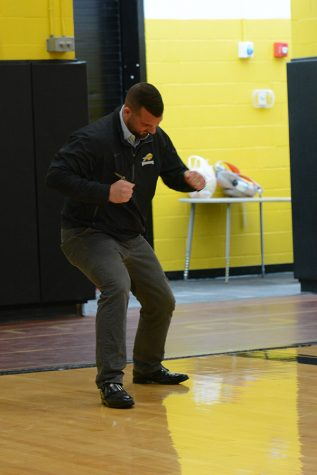 Vice Principal Ryan Patti participates in a pep rally for spring sports.