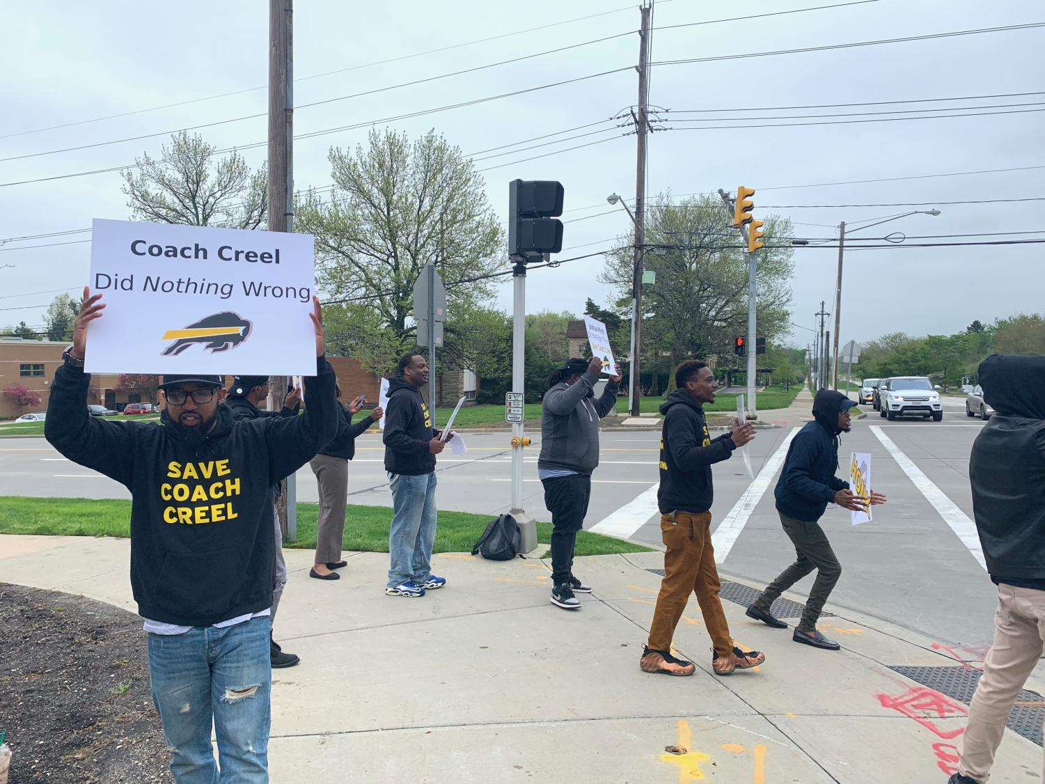 On Friday, May 10, protesters rallied at the corner of Fairmount and Richmond wearing sweatshirts reading 'Save Coach Creel' and handing out flyers demanding he be reinstated.