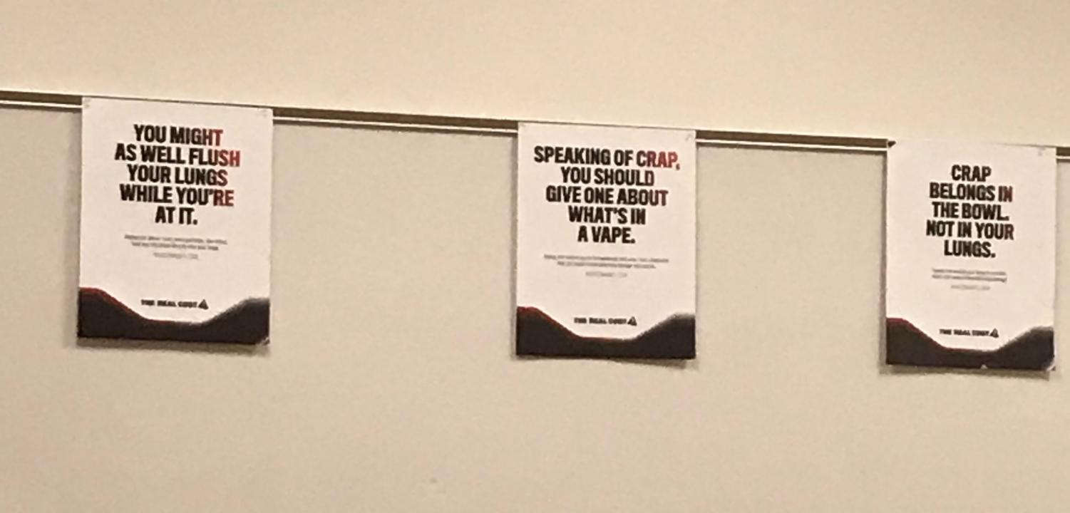 These scatological posters displayed in the main office are intended to dissuade student vaping.