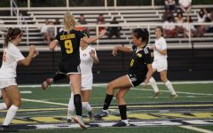 Sunny Wang fights for control of the ball in last year's Orange game.