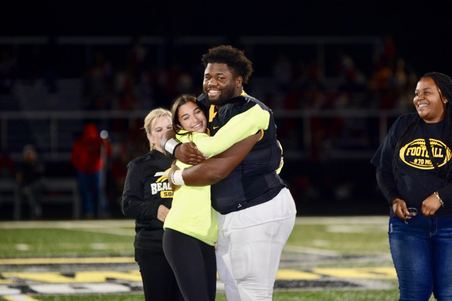 Petti and Roscoe celebrate with a hug after learning they were selected homecoming Queen and King.