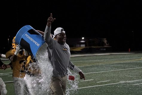 Coach Creel gets drenched in ice water after the first Bison win of the season over Orange.