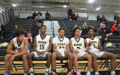 Left to right: Freshman forward Luke Bennett, junior forward Andrew Hill, junior guard Daryl Houston, junior guard Maurice Jones and junior forward Dalanti Jackson wait on the bench right before being introduced as the Bison starters at the Hawken game in December.
