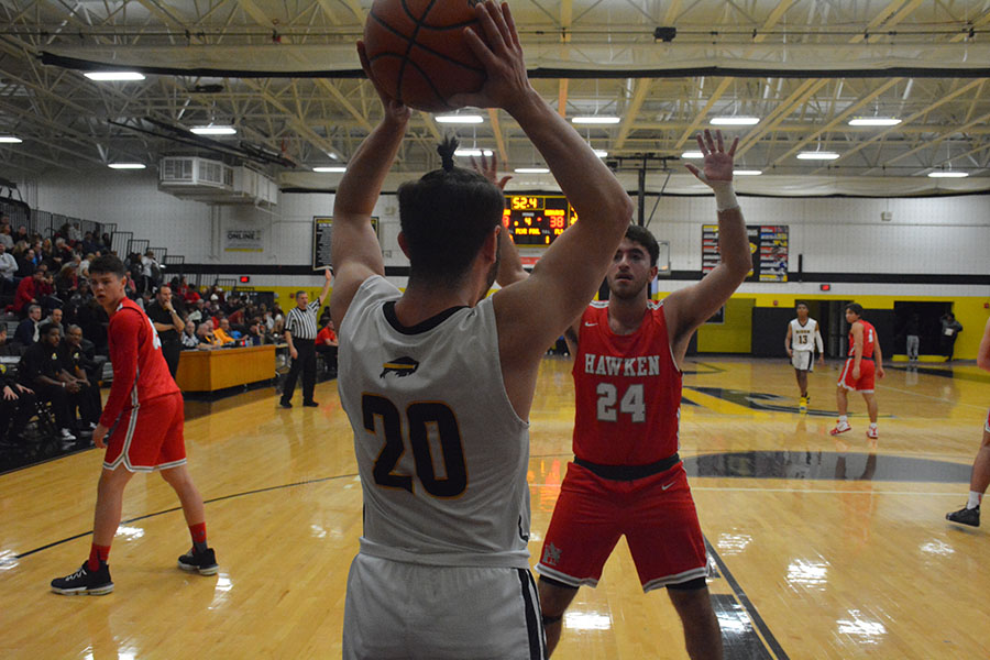 Senior guard Ari Sokol passes the ball in with 52.4 remaining in the game. Hawken junior forward Max Spilman guards the inbound.