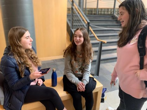 Sophomore Rebecca Shapiro, freshman Hannah Plotkin and freshman Rena Berkowitz react to the news of the three-week school closure.