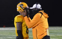 Creel speaks with quarterback Desmond Horne during the second-round playoff game on Oct. 16, 2020. The Bison defeated Warrensville 28-8.