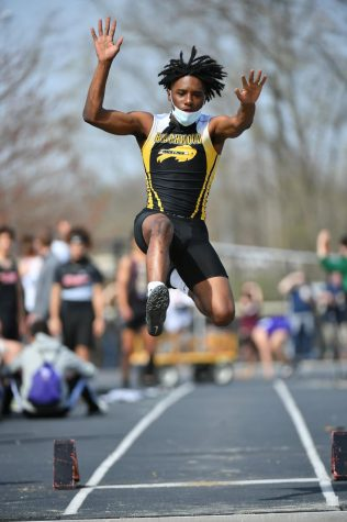 Senior Jasir Holmes soars in the long jump. He will be advancing to regionals in the 4x100 and 4x200 relays.