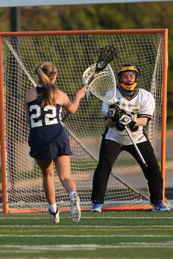 Junior Leah Yakubov defends the goal against a Solon attacker.