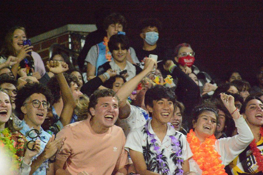 The crowd reacts when Alan Travis is announced for Homecoming Court.