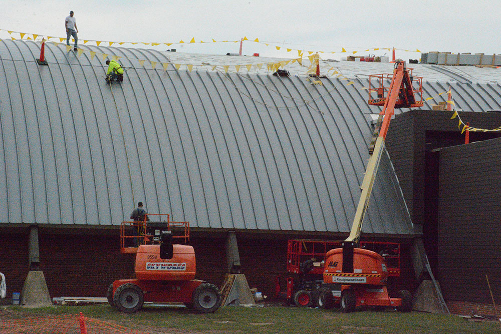 Workers install the new standing seam roof in September.