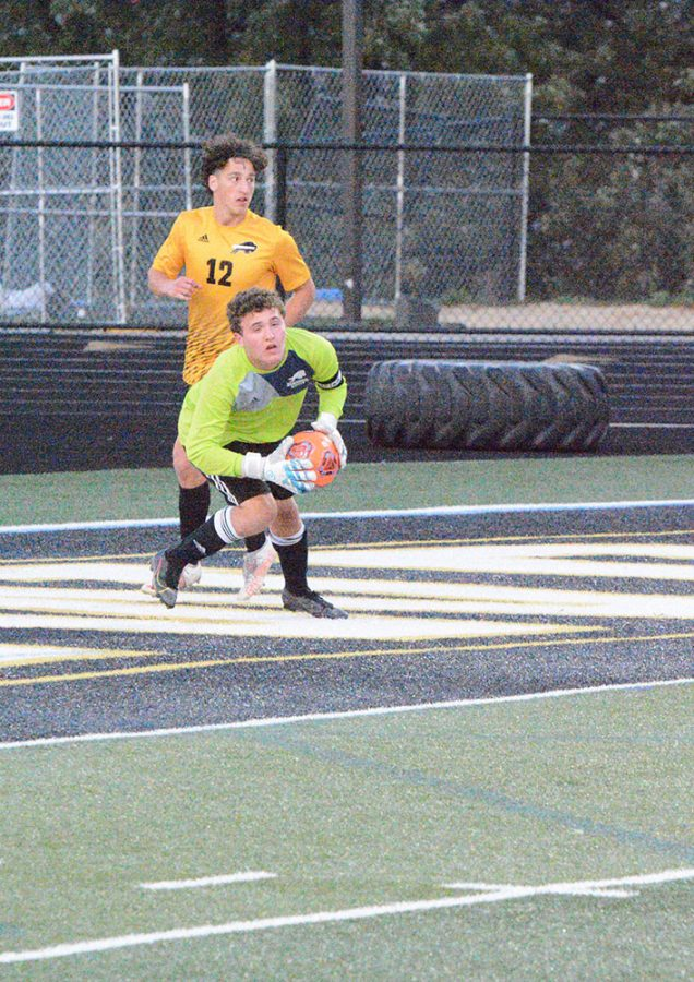 Goalie Jake Muencz leaps for a save.