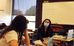 Students in Lisa Morgans math class are masked and three feet apart.
